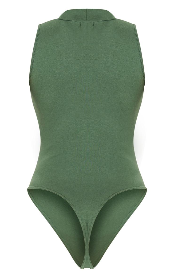 Body en coton vert sans manche à col haut et découpe 6