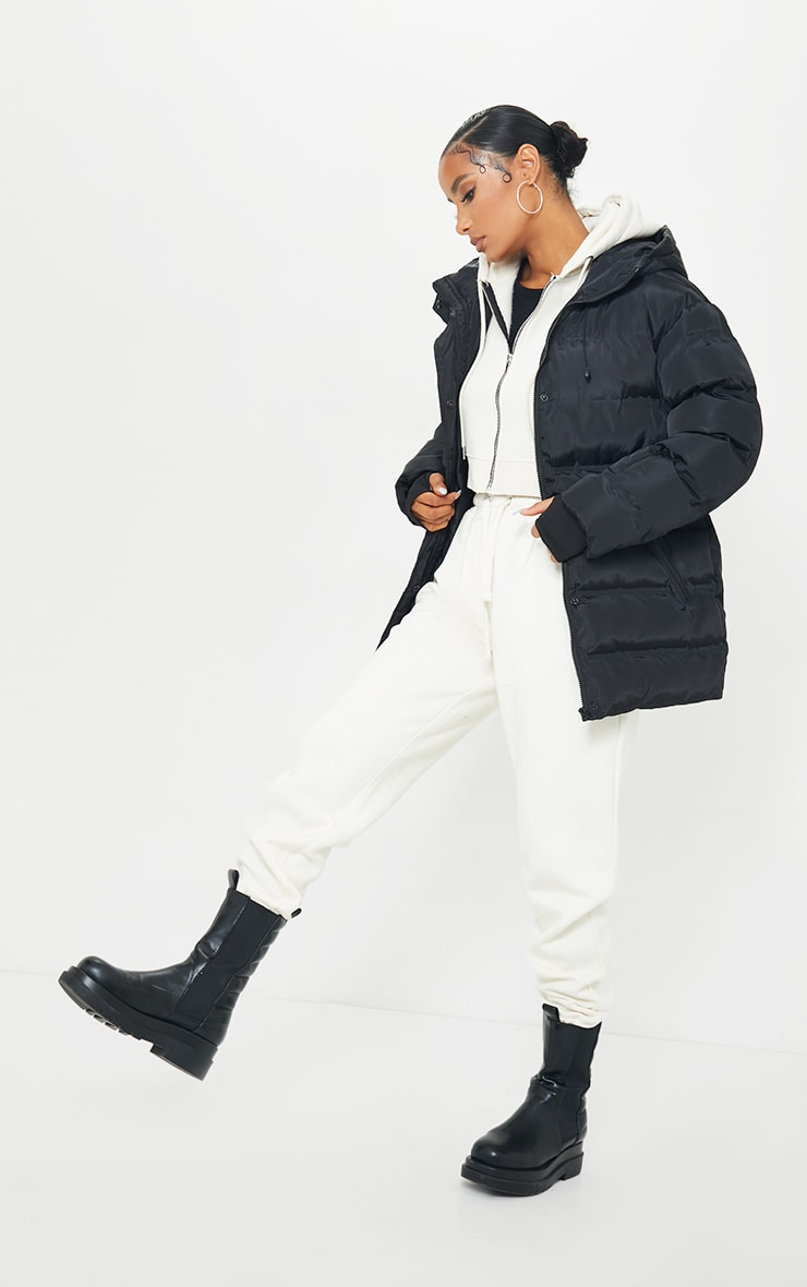 Black Quilted Belted Cuffed Sleeve Puffer Coat. 3