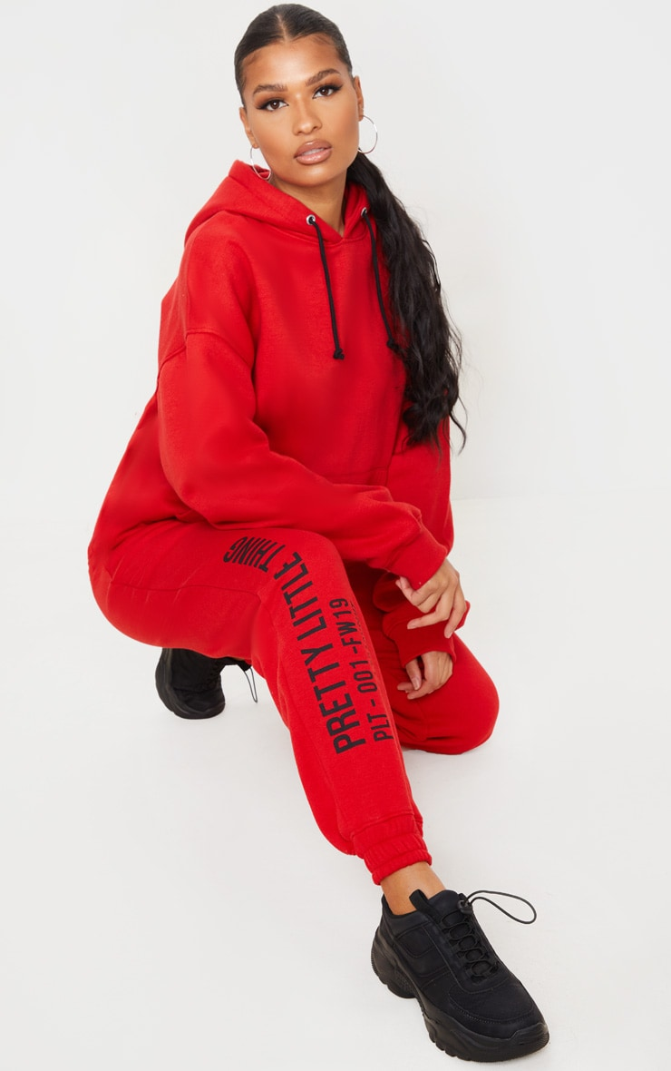 PRETTYLITTLETHING Red Slogan Printed Joggers 1