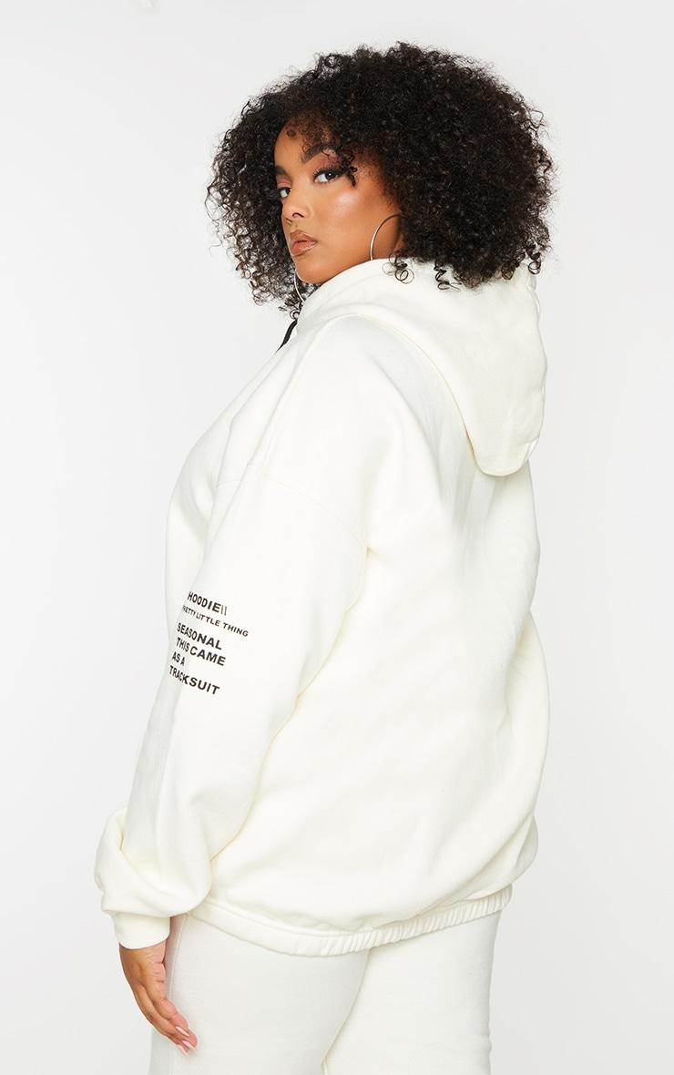 PRETTYLITTLETHING Plus Cream Oversized Slogan Print Pocket Front Hoodie 2