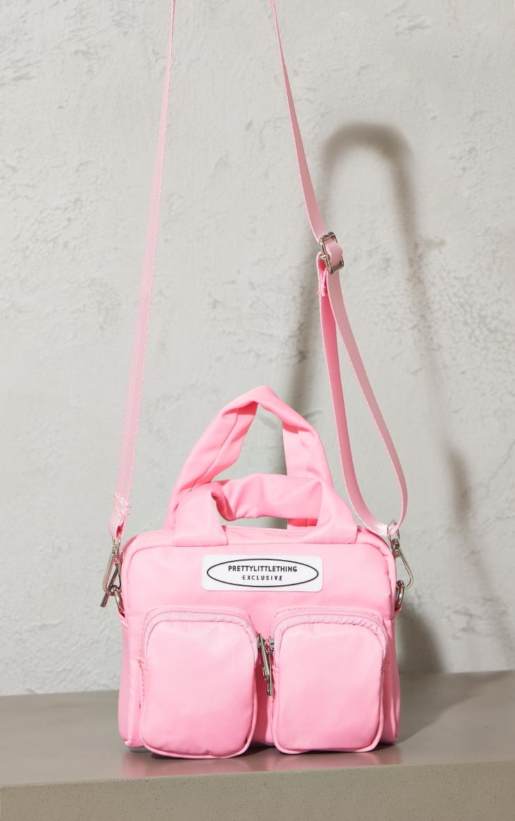 PRETTYLITTLETHING Pink Nylon Double Front Pocket Cross Body Bag 1