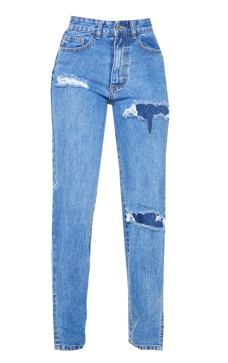 بنطلون جينز أزرق متوسط باهت بقصة جانبية وتفاصيل ممزقة من بيتيت 5