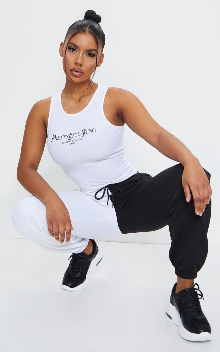 PRETTYLITTLETHING White SS20 Printed Rib Vest 1