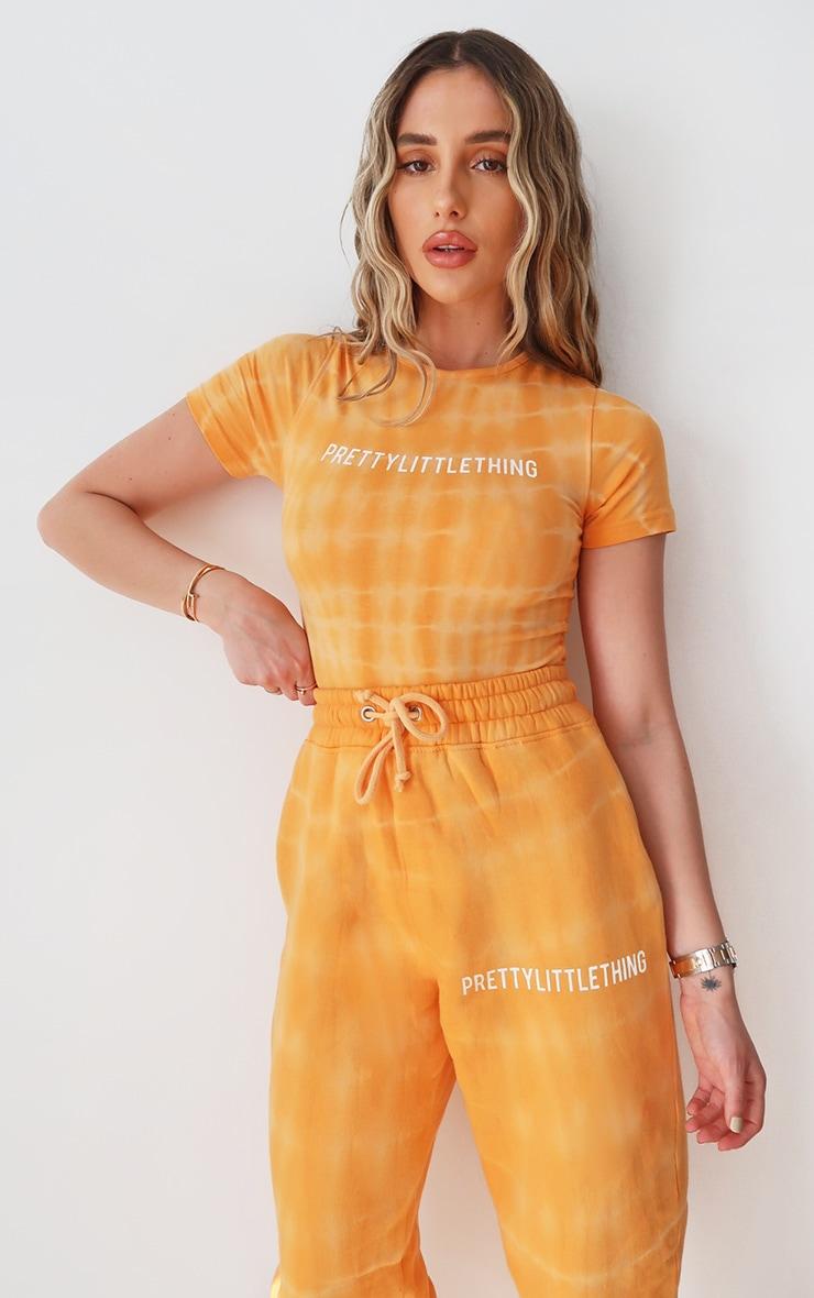 PRETTYLITTLETHING Orange Tie Dye Washed Short Sleeve Bodysuit 1
