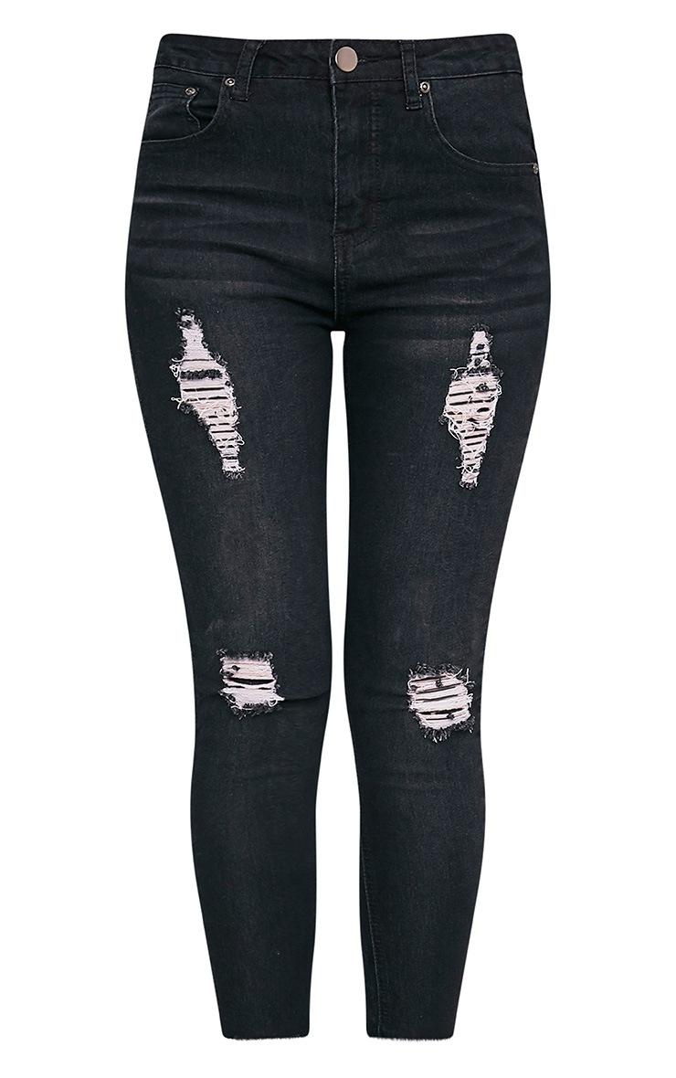 Khloe jean skinny noir taille haute à ourlet déchiré 3