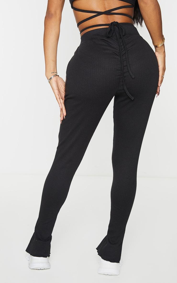 PRETTYLITTLETHING Shape Black Rib Badge Detail Ruched Bum Leggings 3