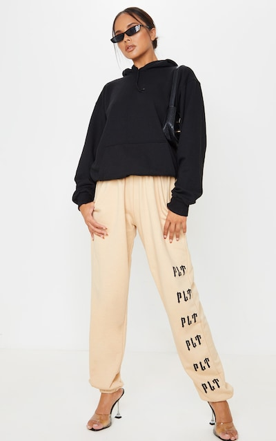 PRETTYLITTLETHING Stone Casual Slogan Jogger