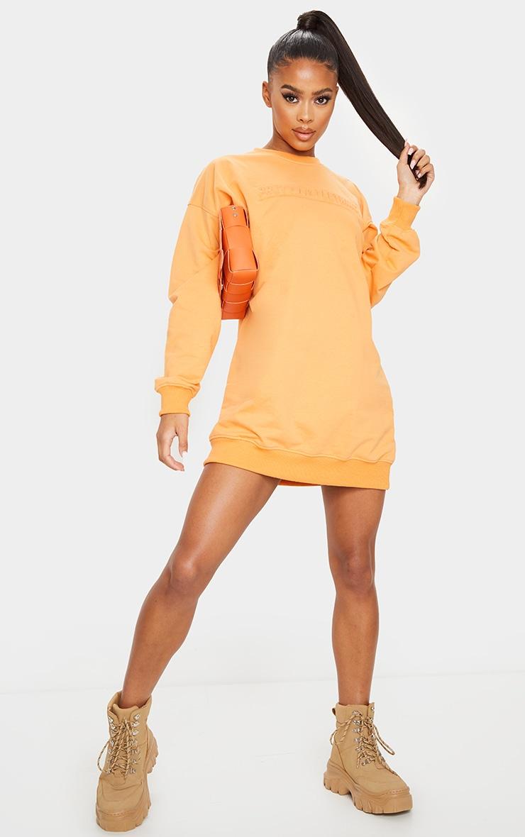 PRETTYLITTLETHING Orange Embossed Slogan Sweat Jumper Dress 3