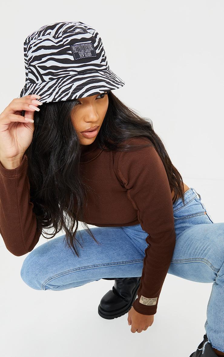 PRETTYLITTETHING Black And White Zebra Bucket Hat 1