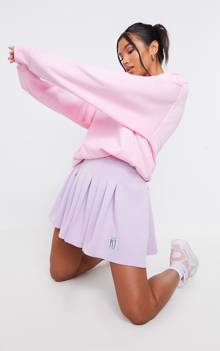 PRETTYLITTLETHING Lilac Badge Pleated Skater Skirt 1
