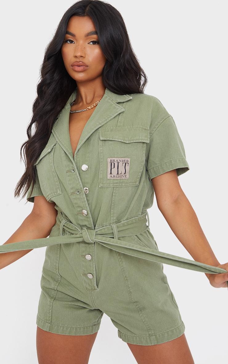 PRETTYLITTLETHING Branded Washed Khaki Tie Waist Button Detail Denim Playsuit