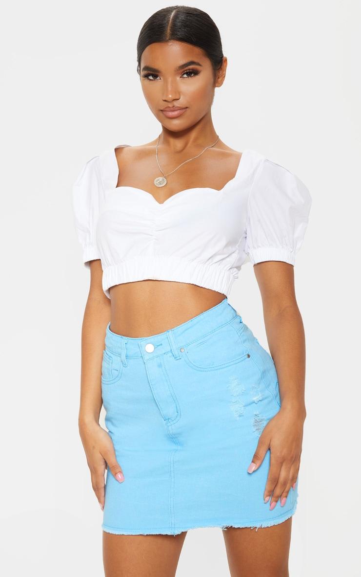 Mini-jupe en jean bleu pâle déchirée  6