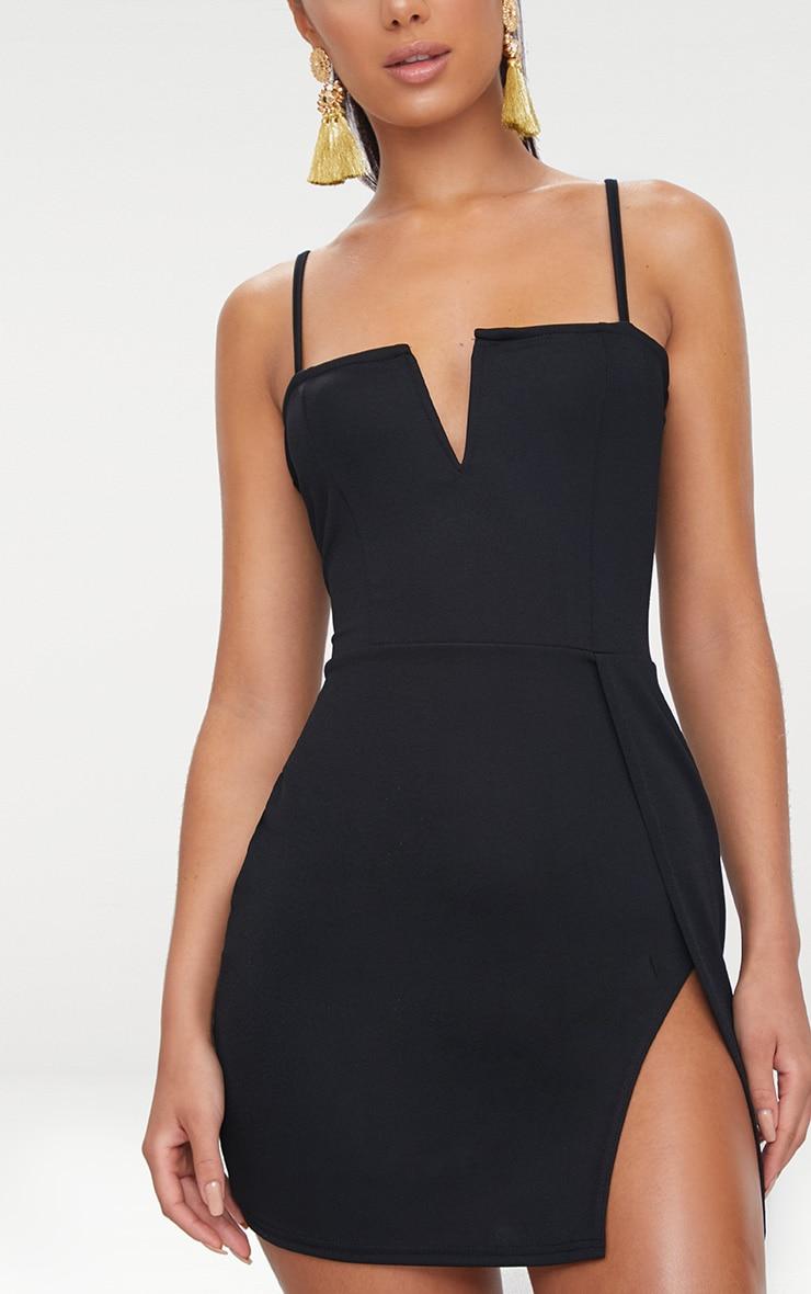 فستان أسود مجسم مخروطي الشكل بفتحة جانبية طويلة عند الفخذ وفتحة عند الصدر 5
