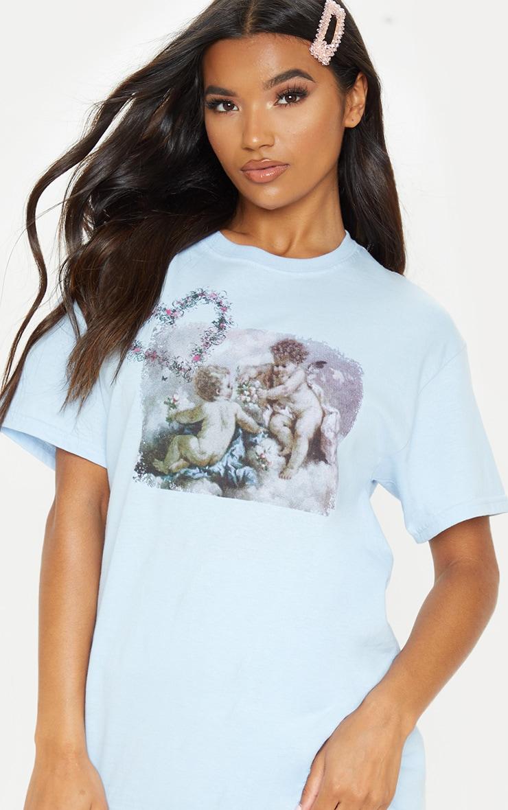 T-shirt oversize bleu à imprimé chérubin  1