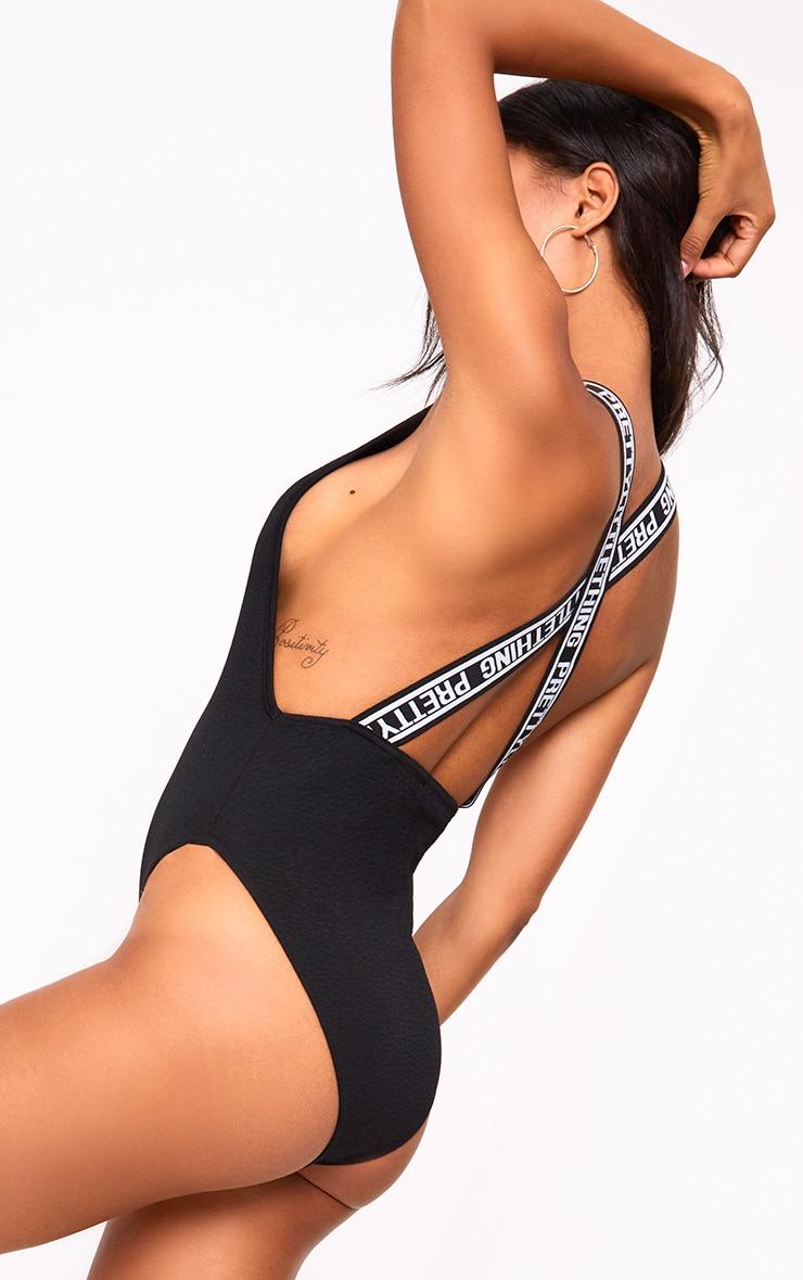 PRETTYLITTLETHING Black Strap Beach One Piece 1