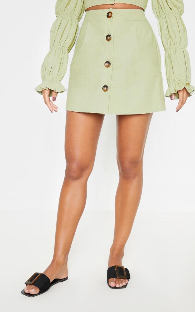 Mini-jupe vert menthe en coton à boutons devant 2