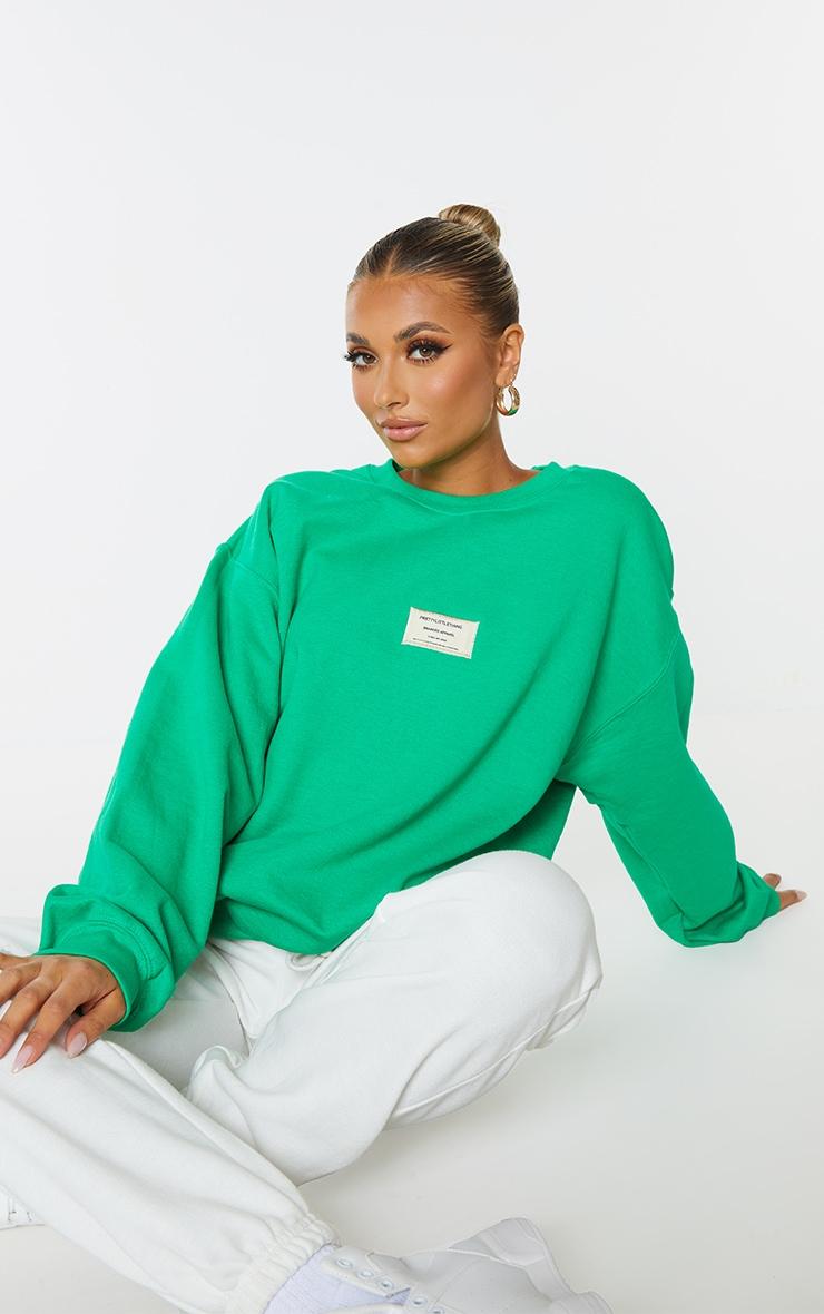 PRETTYLITTLETHING Bright Green Branded Apparel Woven Badge Sweatshirt 1