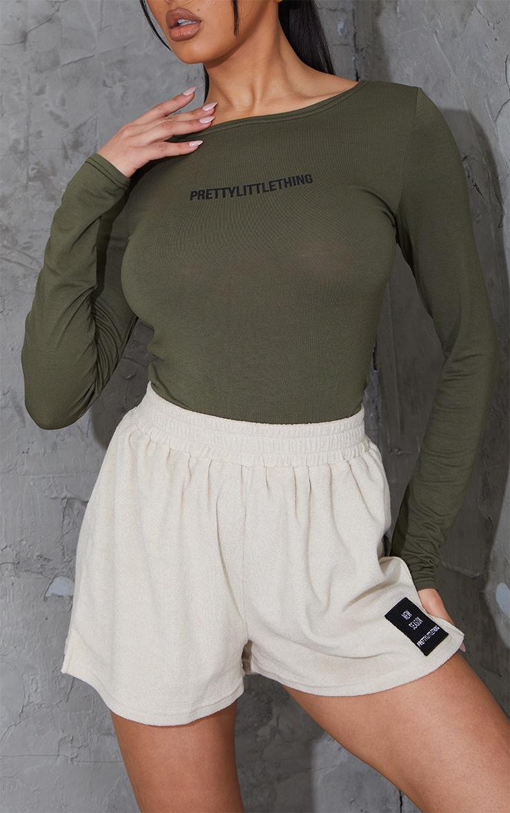 PRETTYLITTLETHING Khaki Long Sleeve Printed Bodysuit 4