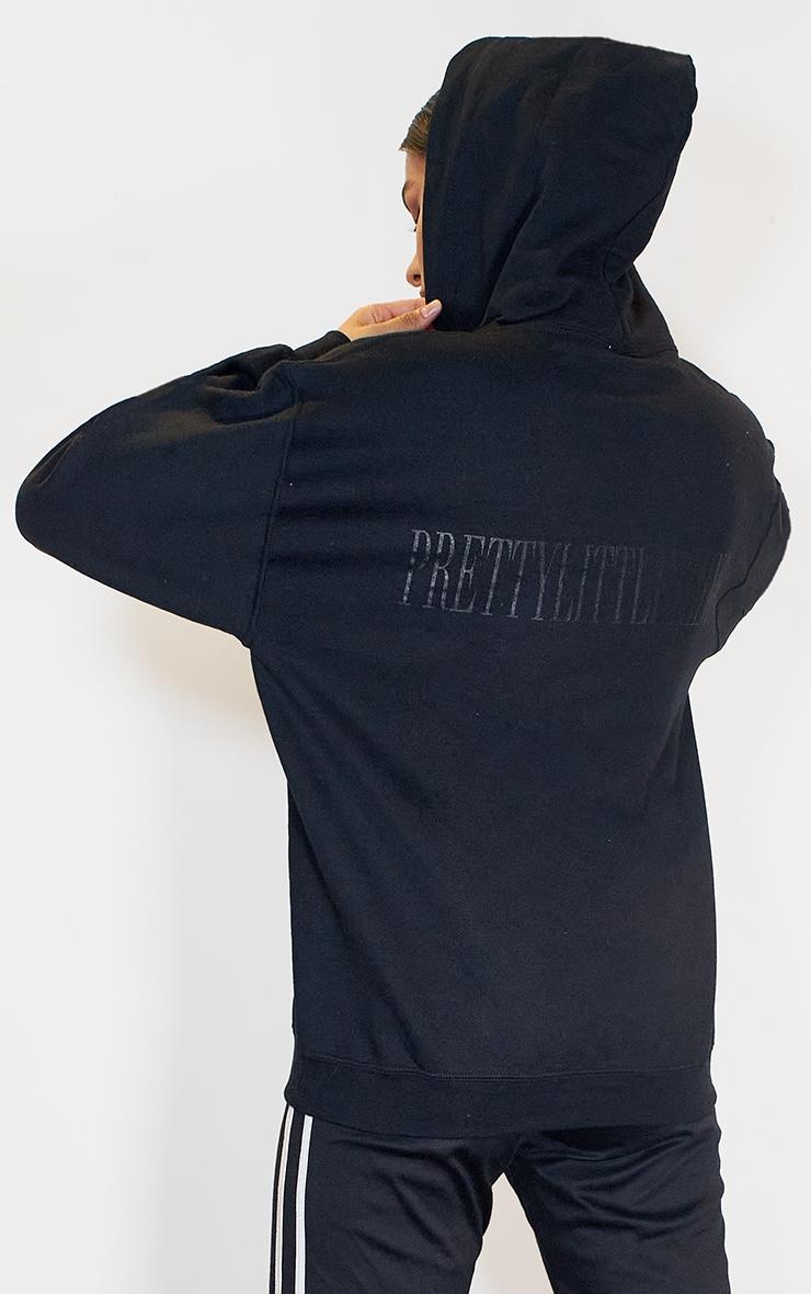 PRETTYLITTLETHING Black Label Back Print Hoodie 1