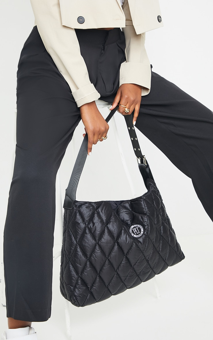 PRETTYLITTLETHING Black Quilted Badge Tote Bag 1