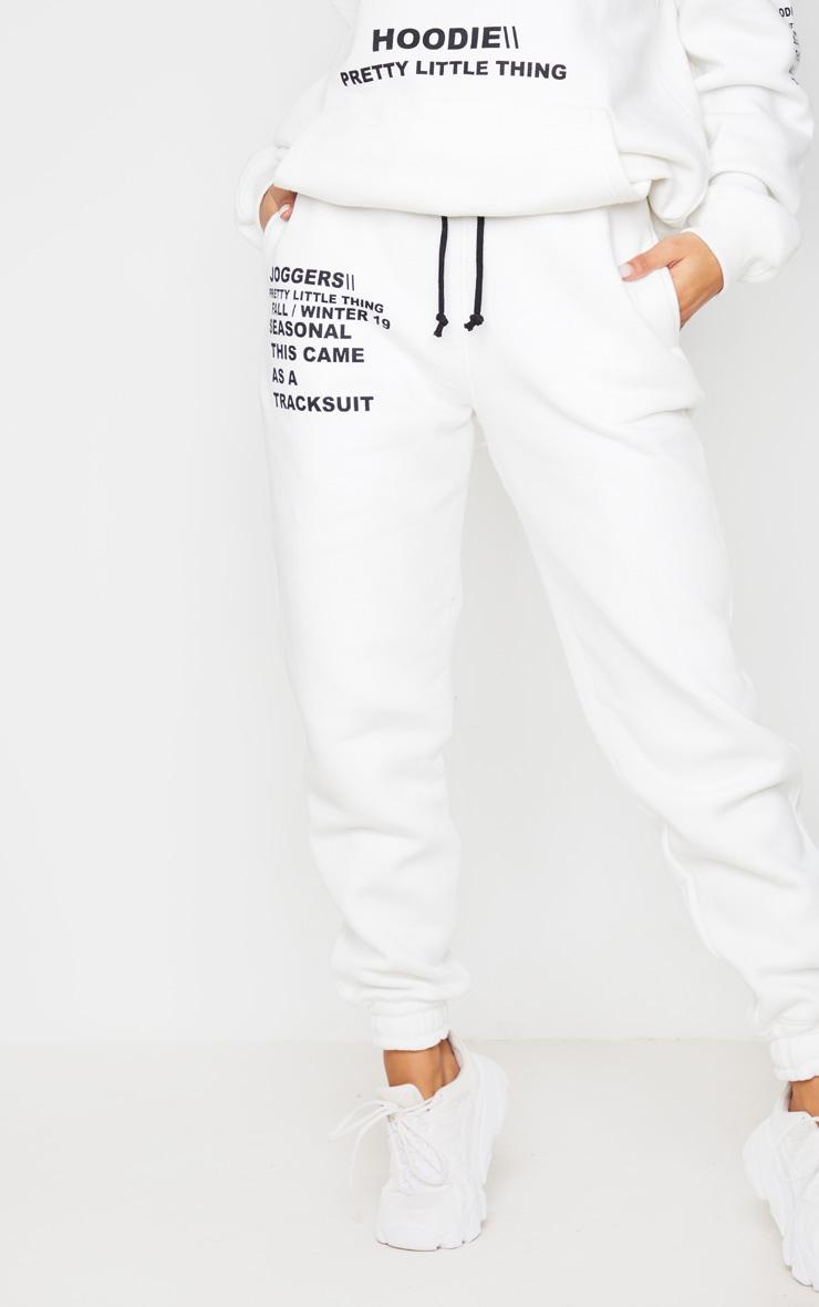 PRETTYLITTLETHING Cream Slogan Printed Jogger 2