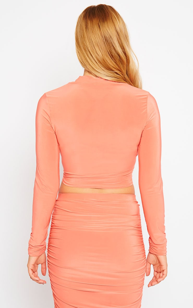 Saylor Orange Slinky Turtle Neck Crop Top 2