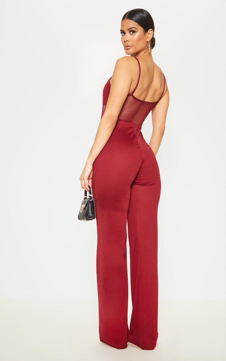 Combinaison en mesh rouge écarlate à buste corset et jambes évasées 2