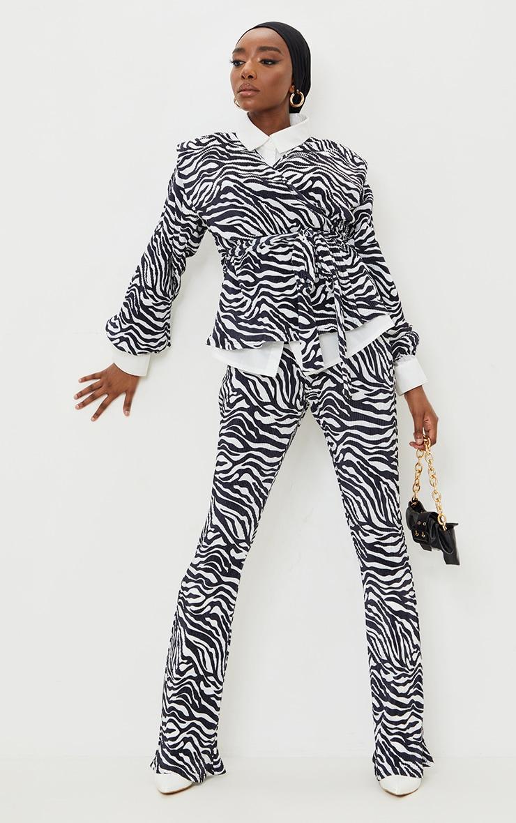 Black Zebra Print Flare Leg Plisse Pants