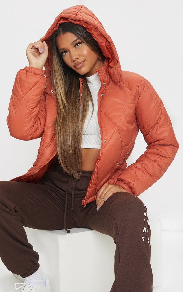 RUST NYLON DIAMOND QUILTED HOODED PUFFER JACKET