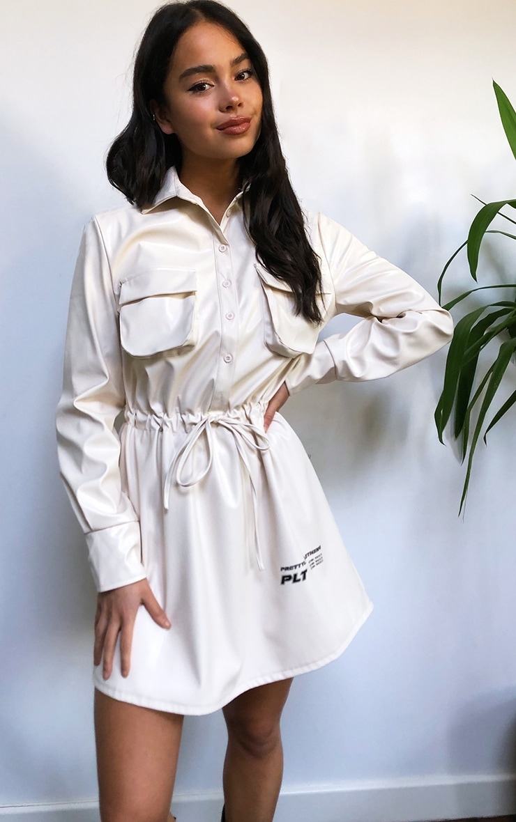 PRETTYLITTLETHING Cream Faux Leather Slogan Pocket Detail Shirt Dress 1