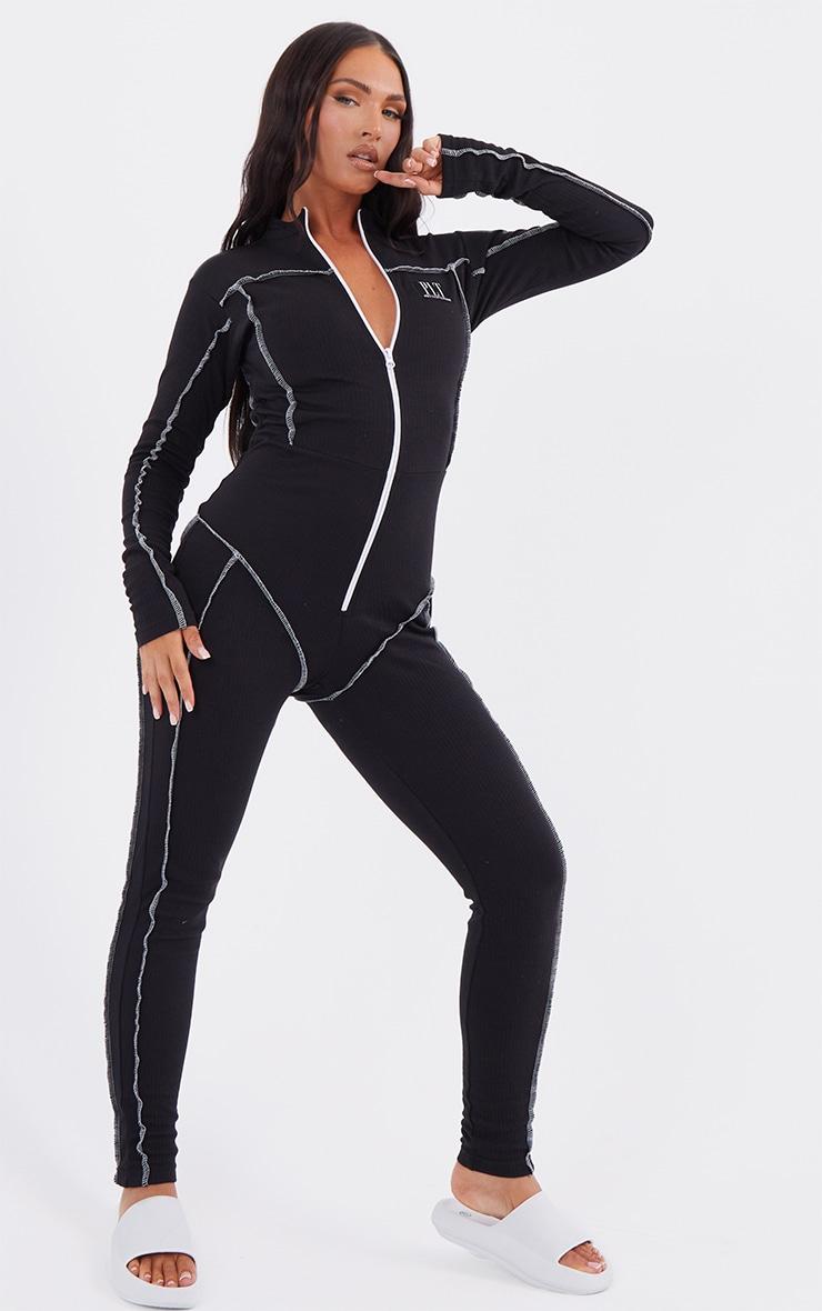 PRETTYLITTLETHING Black Seam Detail Zip Front Rib Jumpsuit 3