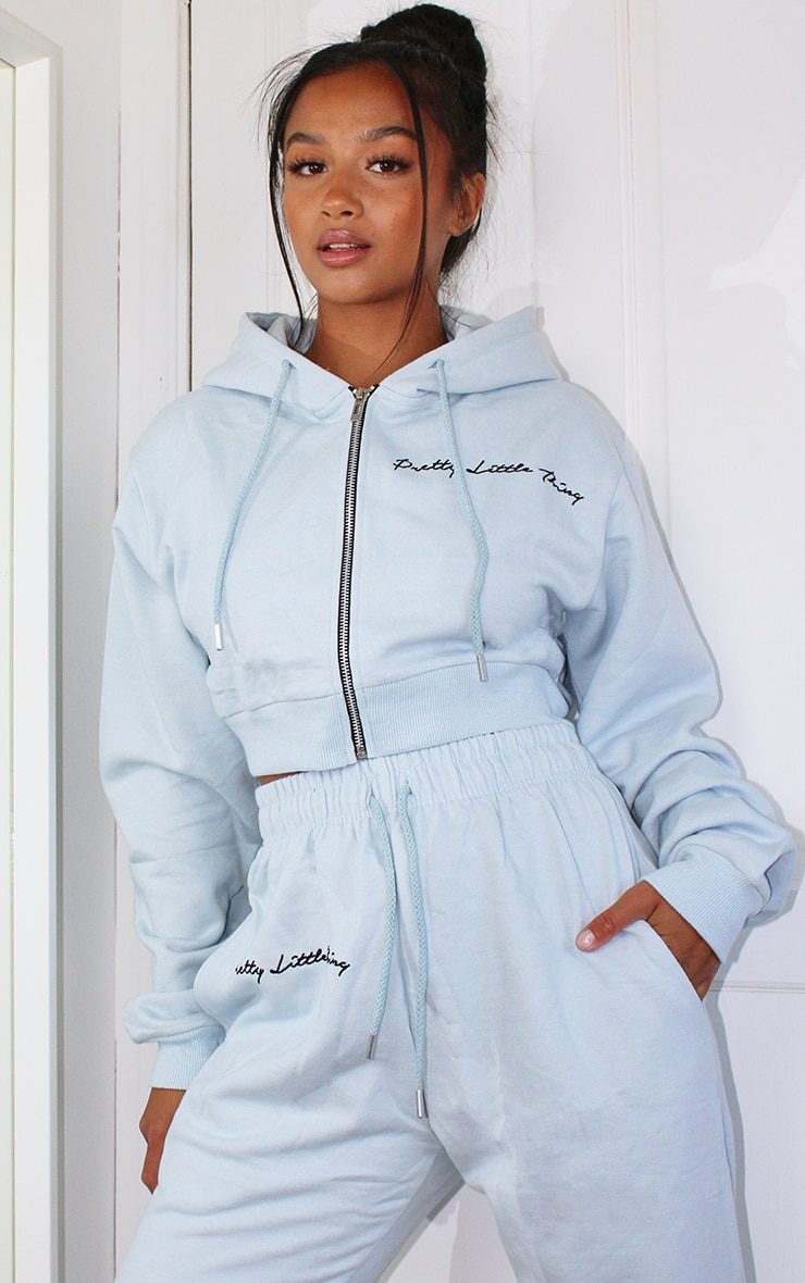 PRETTYLITTLETHING Petite Baby Blue Cropped Embroidered Zip Hoodie 1