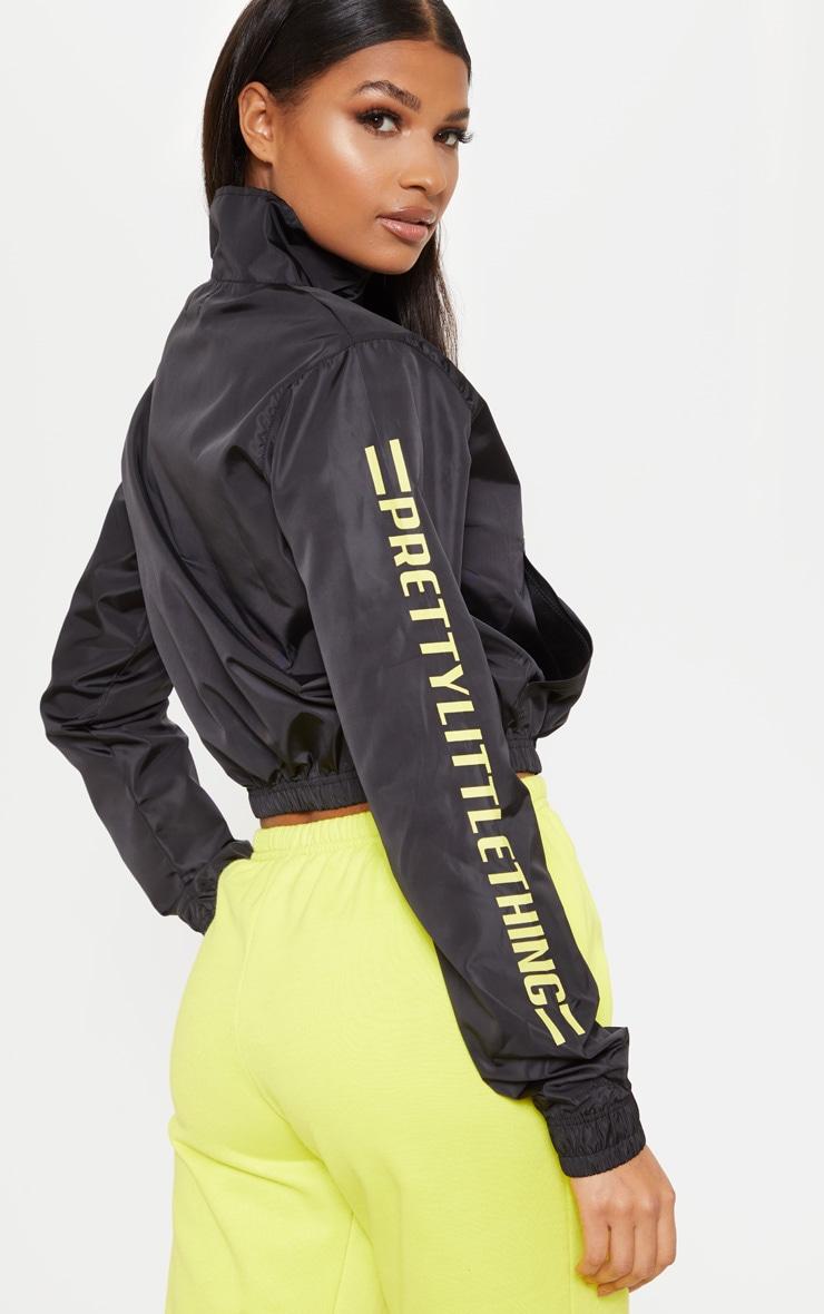 PRETTYLITTLETHING - Top fluide noir à zip et slogan 2