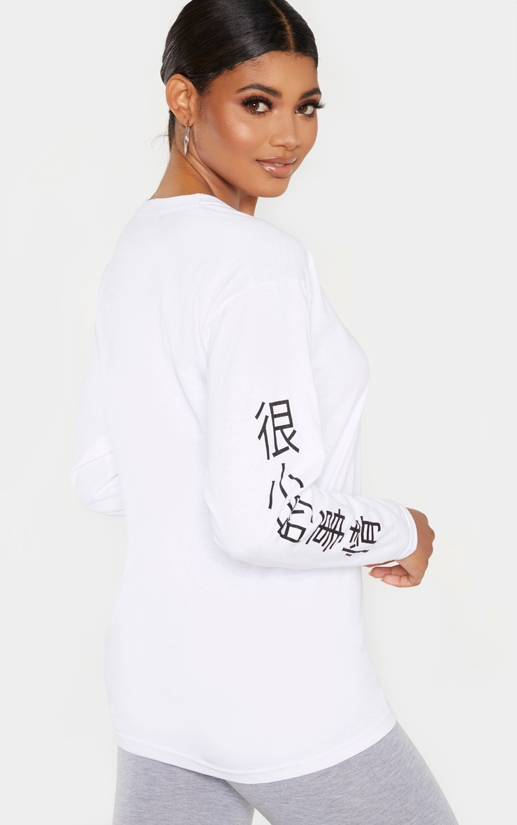 PRETTYLITTLETHING Tall - Top blanc manches longues à slogan 2