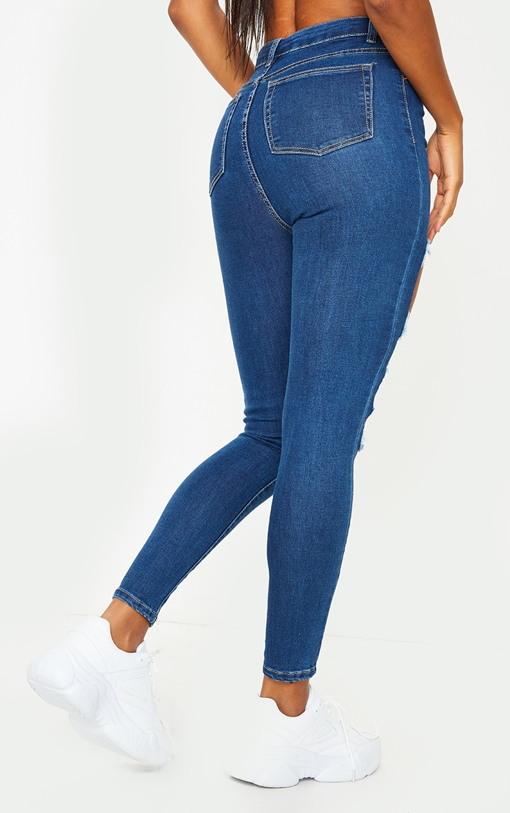 PRETTYLITTLETHING Mid Blue Wash Open Thigh Distressed 5 Pocket Skinny Jeans 3