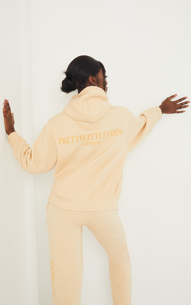 PRETTYLITTLETHING Tall Stone Copyright Hoodie 1