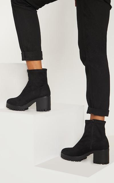 3427a81dd340e Bottes-chaussettes noires à talons épais
