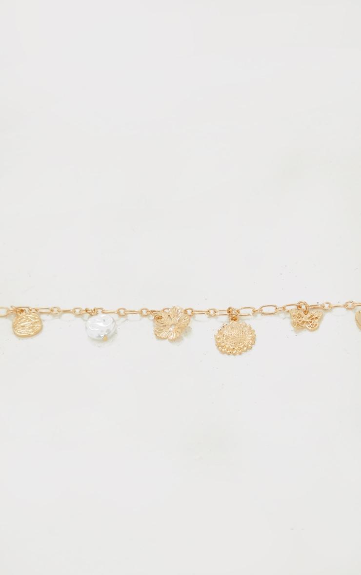 Collier doré à pendentifs variés 3