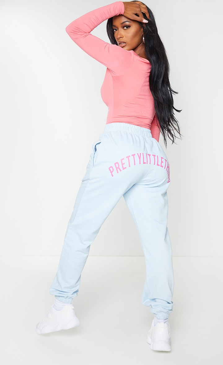 PRETTYLITTLETHING Shape Baby Blue Printed Bum Joggers 1