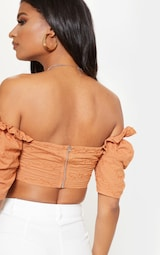 cb754ccd7a7 ... PrettyLittleThing Read more I agree. Previous. Tan Crochet Bardot Puff  Sleeve Crop Top image 2