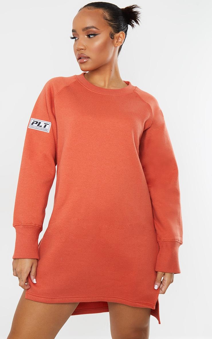 PRETTYLITTLETHING Washed Red Slogan Dip Hem Sweat Sweater Dress 1