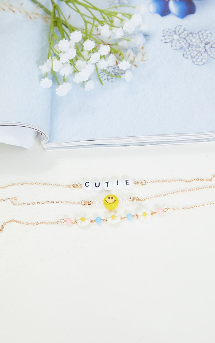 Gold 4 Pack Beaded Flowers and Smiley Face Bracelet Pack 2