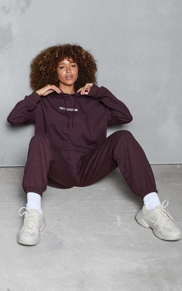 PRETTYLITTLETHING Chocolate Brown Embroidered Slogan Track Pants