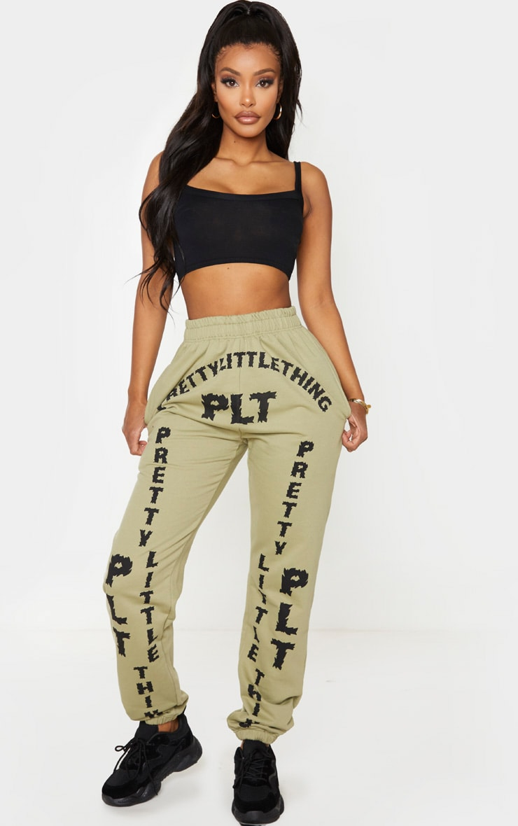 PRETTYLITTLETHING Shape Sage Green Slogan Print Joggers 1