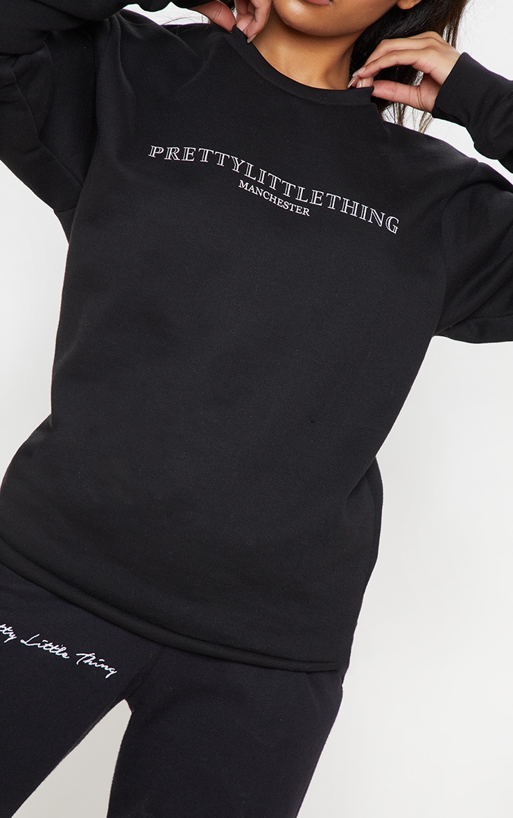 PRETTYLITTLETHING Black Manchester Print Sweater 5