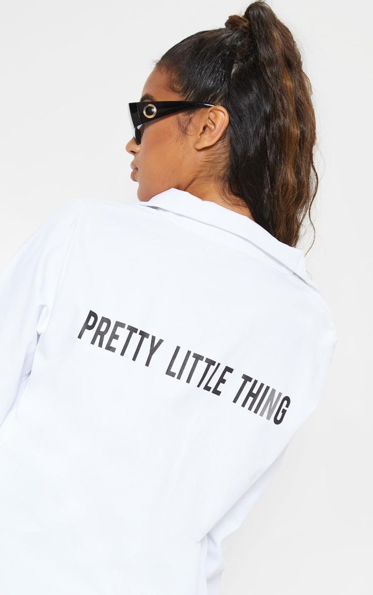 PRETTYLITTLETHING - Chemise blanche à slogan 6