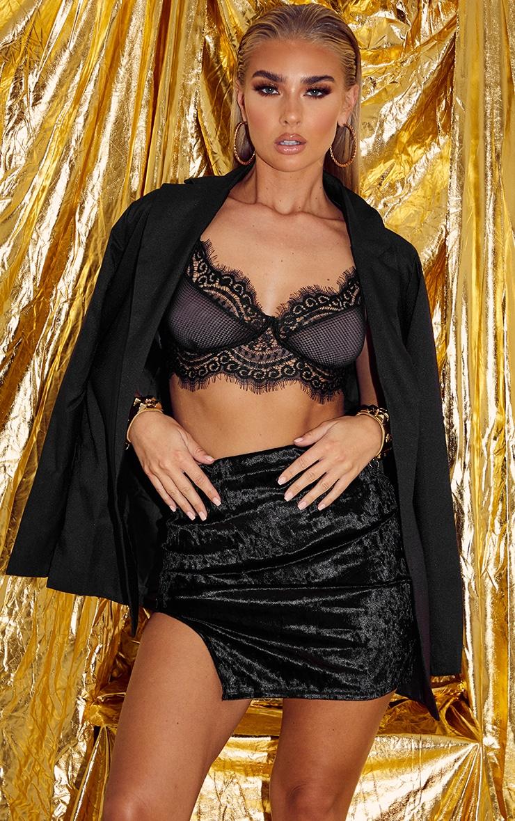 Mini-jupe en velours côtelé noir à détail fendu 1