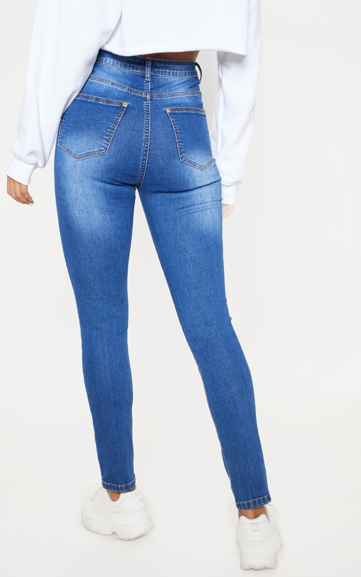 Mid Wash Distressed 5 Pocket Skinny Jean 4