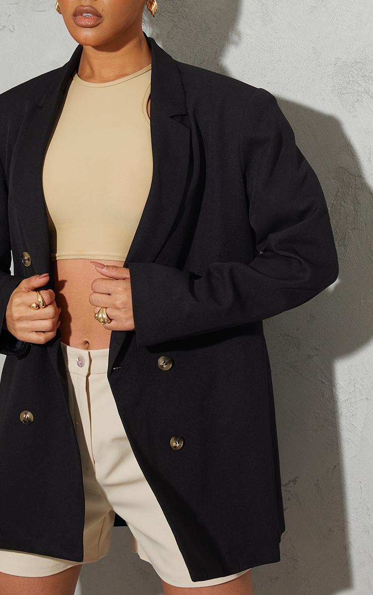 Blazer oversize noir en maille tissée à épaulettes et boutons écailles de tortue 4