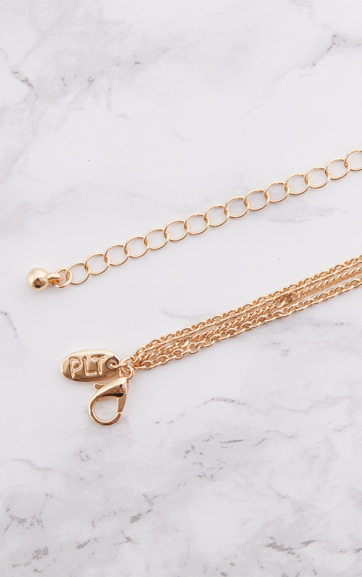 Gold Diamante Swallow Anchor Triple Layer Necklace 4